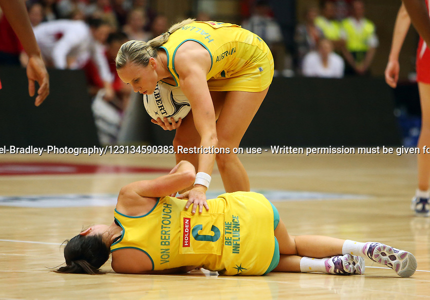 28.10.2012 Australia's Natalie Von Bertouch and Renae Hallinan in action during the netball test match between Australia and England as part of the Quad Series played at the TECT Arena in Tauranga. Mandatory Photo Credit ©Michael Bradley.