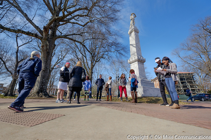 Students, faculty and staff gather at the Confederate Memorial statue to take the Hidden History Tour of lesser-known Ole Miss history led by a member of the University of Mississippi chapter of the NAACP. Photo by Robert Jordan/Ole Miss Communications