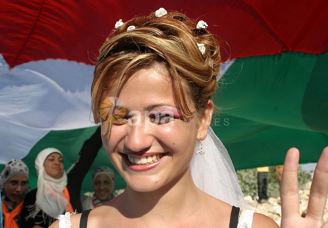 , Friday, July 31, 2009. The couples said they were there as a creative form of protest to show how hard it is for Palestinians to move around and live in the West Bank. Photo by Najeh Hashlamoun