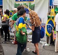 Brazilians are surveyed by a polling firm using and iPad at the 28th Annual Brazil Day Festival in New York on Sunday, September 2, 2012.  The festival, which features food. music and other aspects of Brazilian culture, centers around West 46th Street in Midtown Manhattan, known as Little Brazil. (© Richard B. Levine)