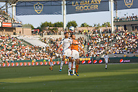 LA Galaxy defender Sean Franklin (28) defending against Houston Dynamo midfielder Brad Davis (11) for a headball. The LA Galaxy defeated the Houston Dynamo 4-1 at Home Depot Center stadium in Carson, California on Saturday evening June 5, 2010..
