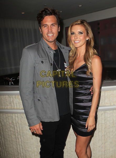 Corey Bohan & Audrina Patridge.5th Annual Sunset Strip Music Festival Held At  SkyBar at Mondrian, West Hollywood, California, USA, .17th August 2012..half length black grey gray bandage dress couple boyfriend .CAP/ADM/KB.©Kevan Brooks/AdMedia/Capital Pictures.