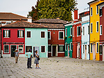 Colorful building in the plaza, the colorful village of Burano, Italy.