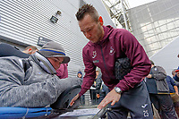 Erwin Mulder of Swansea City signs an autograph for a fan as he arrives prior to the game during the Sky Bet Championship match between Preston North End and Swansea City at Deepdale, Preston, England, UK. Saturday 12 January 2019