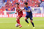 Haraguchi Genki of Japan (R) fights for the ball with Do Hung Dung of Vietnam (L) during the AFC Asian Cup UAE 2019 Quarter Finals match between Vietnam (VIE) and Japan (JPN) at Al Maktoum Stadium on 24 January 2019 in Dubai, United Arab Emirates. Photo by Marcio Rodrigo Machado / Power Sport Images