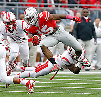 Ohio State Buckeyes running back Ezekiel Elliott (15) jumps into the air to get past a Rutgers Scarlet Knights defender during the 1st quarter of their game at Ohio Stadium on October 18, 2014.   (Dispatch photo by Kyle Robertson)