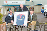 JERSEY WIN: Eamon Browne, on behalf of his mother Kathleen, who won the after sales service draw of a framed Munster Rugby Jersey, collects the prize from Tim Kelliher and Kevin Williams. Kathleen is recovering from a knee operation and all at Kellihers wish her well l-r: Tim Kelliher (Director Kellihers), Eamon Browne and Kevin Williams (after sales service, Kellihers, Tralee).