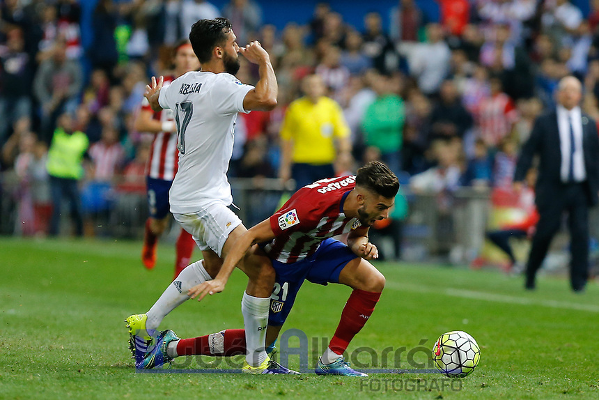 Real Madrid's Spanish defense Alvaro Arbeloa and Atletico Madrid´s Carrasco