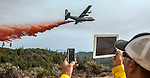 Dozer boss uses cell phone and tablet to photograph California Air National Guard C-130 as it drops retardant on Division S, below Pilot Peak, at Old Yosemite Road, to protect the Greeley Hill community after spot fire escaped the southwest corner of the Rim Fire the night before.