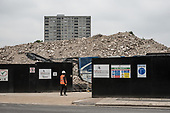 Rubble from the demolition of Gloucester House, in front of the scheduled-for-demolition 18 storey Herefordshire House, South Kilburn Estate, London Borough of Brent.
