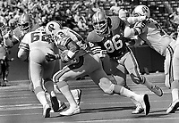 Tampa Bucs Ricky Bell running 49er Cedrick Hardman.<br />(1977 photo/Ron Riesterer)
