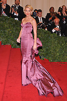 Amber Heard at the 'Schiaparelli And Prada: Impossible Conversations' Costume Institute Gala at the Metropolitan Museum of Art on May 7, 2012 in New York City. © mpi03/MediaPunch Inc.