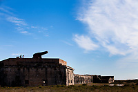 Visitors stand on Fort Pickens, the largest of four forts built to protect Pensacola Bay. Begun in 1829 it was used until 1947.<br /> <br /> <br /> COLIN HACKLEY PHOTO