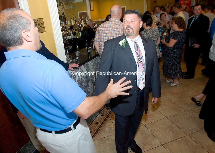WATERBURY, CT- 06 MAY 2008- 050608JT12-<br /> Long-time Waterbury Police Detective and Waterbury Police Union President Paul Ariola talks to former union vice president Jeff Taylor during Ariola's surprise retirement party at the Villa Rosa in Waterbury on Tuesday. Paul Ariola worked in the police department for almost 30 years, and as union president for eight years. Ariola is one of about a dozen experienced officers who are the last to retired with the benefits of the old contract.<br /> Josalee Thrift / Republican-American