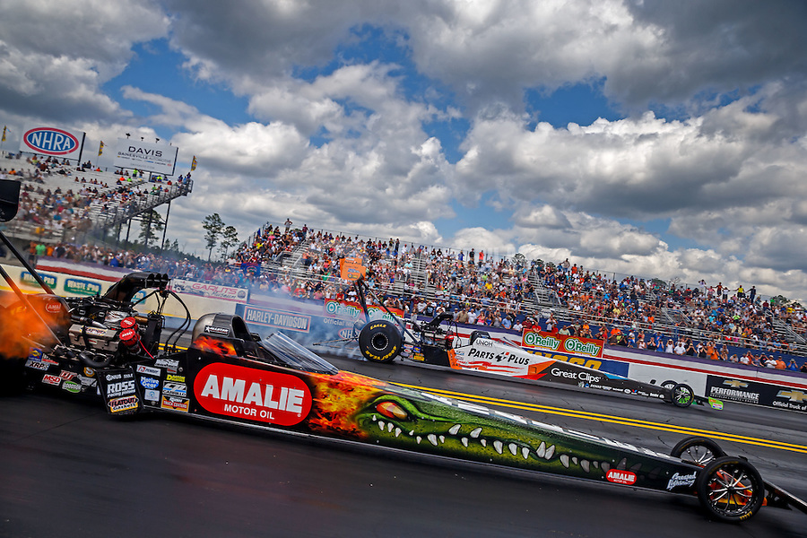 Mar 20, 2016; Gainesville, FL, USA; NHRA top fuel driver Terry McMillen (near) against Clay Millican during the Gatornationals at Auto Plus Raceway at Gainesville. Mandatory Credit: Mark J. Rebilas-USA TODAY Sports