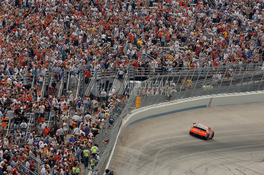 Sept. 24, 2006; Dover, DE, USA; Nascar Nextel Cup driver Jeff Burton (31) celebrates after winning the Dover 400 at Dover International Speedway. Mandatory Credit: Mark J. Rebilas