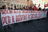 "Rome, 25/06/2020. Today, hundreds of people, led by ""Priorià Alla Scuola"" (1.) and supported by trade unions and other organizations, gathered in Piazza San Silvestro, near the Parliament, to call the Italian Government to massively invest in Public Education and implement policies - post Covid-19/Coronavirus emergency - allowing Public Schools to restart in September without the use of distance education. From the Organisers Facebook event page (2.): «[…] The school community needs to start in September ""in Presenza"" [as always with class and face-to-face lessons, and not via web/online education/online learning/distance education, ndr] : girls, boys, young people, teachers, workers, families have endured for three months - materially and psychologically - to face an emergency. After this huge collective effort and when all the productive activities of the country have already restarted, it is time to say enough: the school community needs to start again in September ""in Presenza"" because without school there is no politics, there is no justice, there is no equality, there is no growth - neither human nor economic. [Protesters] Requests: 1. extraordinary resources; 2. teaching staff and ATA appropriate to the needs of the school; 3. hiring all precarious teachers from the provincial rankings; 4. Municipalities and Provinces find spaces for all schools of all levels; 5. structural investments for school buildings; 6. health prevention in schools. [Protesters] Rejects: 1. the reduction of school time; 2. outsourcing (all precarious work) to complete school time; 3. the 40 min hours; 4. DAD as a structural part of the school timetable. Education is a right […]». The demo was held contemporary in at least other 56 squares across Italy.<br />