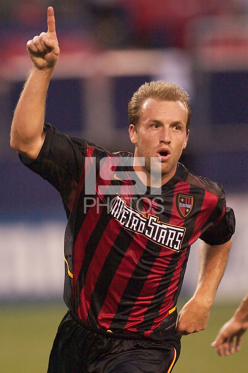 Clint Mathis celebrates scoring his first of two goals for the game in the 43rd minute. The San Jose Earthquakes and the the NY/NJ MetroStars played to a 4-4 tie on 7/02/03 at Giant's Stadium, NJ..