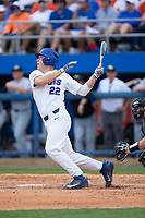 JJ Schwarz (22) of the Florida Gators follows through on his swing against the Wake Forest Demon Deacons in Game One of the Gainesville Super Regional of the 2017 College World Series at Alfred McKethan Stadium at Perry Field on June 10, 2017 in Gainesville, Florida.  The Gators defeated the Demon Deacons 2-1 in 11 innings.  (Brian Westerholt/Four Seam Images)
