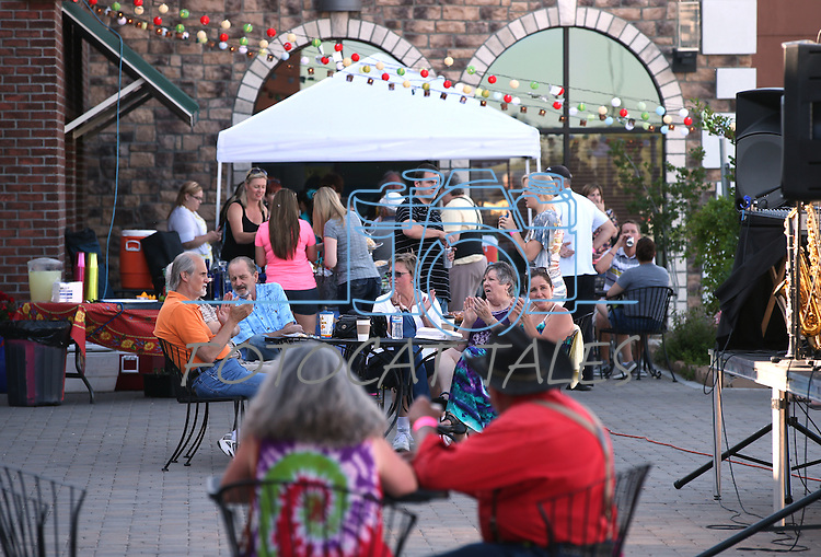 Crowds listen as the Millennium Bugs perform at the Carson Mall during the 20th annual Taste of Downtown event in Carson City, Nev., on Saturday, June 15, 2013. The event features 44 local restaurants in a fundraiser for the Advocates to End Domestic Violence.<br /> Photo by Cathleen Allison
