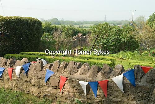 Bunting Flags Somerset  UK Preparations of the Queens Diamond Jubilee.