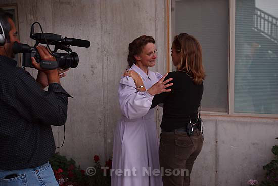 """Eldorado - FLDS women speak to the media after they were removed from their children Monday, April 14, 2008, at the YFZ """"Yearning for Zion"""" Ranch. This was the first time that the media was invited onto the ranch; 04.14.2008 reporter hugs marie"""