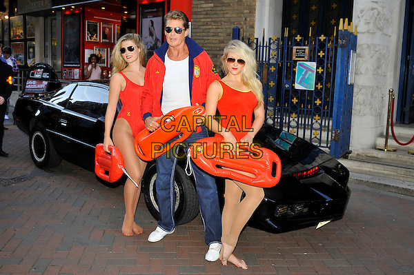 David Hasselhoff .photocall at Leicester Square Theatre, Leicester Square, London, England, UK,.17th August 2012..full length baywatch sunglasses red jacket girls floats swimsuits black car .CAP/MAR.© Martin Harris/Capital Pictures.