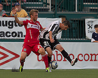 Chicago Fire defender Pari Pantazopoulos (24) and Rochester Rhinos midfielder Tony Donatelli (21) battle for the ball. In a Third Round U.S. Open Cup match, the Chicago Fire defeated the Rochester Rhinos, 1-0, at Sahlens Stadium on June 28, 2011.