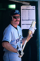 OAKLAND, CA - Wade Boggs of the Tampa Bay Devil Rays gets ready to bat in the dugout during a game against the Oakland Athletics at the Oakland Coliseum in Oakland, California in 1999.  Photo by Brad Mangin
