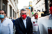 """Maurizio Landini, General Secretary of CGIL (Italian General Confederation of Labour, 1.).<br /> <br /> Rome, 29/07/2020. Today, the three main Italian Trade Unions: CGIL (Italian General Confederation of Labour, General Secretary Maurizio Landini, 1.), CISL (Italian Confederation of Workers' Trade Union, General Secretary Anna Maria Furlan, 2.), UIL (Italian Labour Union, General Secretary Pierpaolo Bombardieri, 3.). held a demonstration in Piazza Santi Apostoli called """"La notte per il Lavoro. Ricostruire il Paese e l'Europa partendo dal buon lavoro"""" (The night for work. Rebuilding Italy and Europe from the good work). Given the crisis caused by the pandemic Covid-19 / Coronavirus, the three General Secretaries asked the Government to block layoffs, an extension of the social safety nets until the end of the year, a tax reform and the fight against tax evasion, the private and public national contractual renewals, investments, health, safety at work, Research, culture, tangible and intangible infrastructures, stable work, digitalization, South of Italy, social security, law on non self-sufficiency, social inclusion and solution of open company crises. Moreover, to urge the government to start an urgent discussion to plan the spending strategy that is about to be launched to use the resources of the EU """"Recovery Fund"""".<br /> <br /> Footnotes & Links:<br /> 1. http://cgil.it/ & https://bit.ly/2E1Al5a (Wikipedia)<br /> 2. https://www.cisl.it /& https://bit.ly/2tj5Txa (Wikipedia)<br /> 3. http://www.uil.it/ & https://bit.ly /2Glf88D (Wikipedia)<br /> 09.02.19 CGIL, CISL, UIL - Trade Unions National Demo in Rome #FuturoalLavoro http://bit.do/fG7GK"""