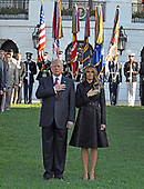 """United States President Donald J. Trump and first lady Melania Trump place their hands over their hearts as a bugler blows """"Taps"""" as they lead a moment of silence in remembrance of those lost on September 11, 2001 on the South Lawn of the White House in Washington, DC on Monday, September 11, 2017.<br /> Credit: Ron Sachs / CNP"""