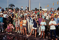 Cape Kennedy, FL - July 16, 1969<br /> An excited crowd gazes up to the sky as Apollo XI hurtles towards the moon.  On the morning of July 16, 1969 astronauts Neil Armstrong and Buzz Aldrin piloted the Apollo XI into space to achieve probably the most historic moment in Space exploration history. Four days later, after entering the lunar orbit, the two touched down in the &lsquo;Sea of Tranquility&rsquo; and Armstrong famously uttered the first words ever spoken by a human on the moon, &lsquo;One small step for man, one giant leap for mankind&rsquo; as he stepped on the moon&rsquo;s surface. <br /> <br /> Cape Kennedy, Floride. 16 juillet 1969.<br /> Il est 9h32 du matin la fus&eacute;e qui va porter la capsule Apollo XI sur la lune vient de partir. Les gens la regardent s&rsquo;&eacute;lever, enthousiastes, ils hurlent de joie ! Quatre jours plus tard le 20 juillet Armstrong prononcera cette phrase rest&eacute;e dans les m&eacute;moires&hellip; &ldquo;C&rsquo;est un petit pas pour l&rsquo;homme mais un pas de g&eacute;ant pour l&rsquo;humanit&eacute;&ldquo;.