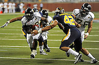 26 December 2010:  FIU running back Darriet Perry (28) carries the ball for a touchdown in the third quarter as the FIU Golden Panthers defeated the University of Toledo Rockets, 34-32, to win the 2010 Little Caesars Pizza Bowl at Ford Field in Detroit, Michigan.