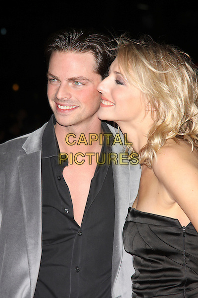 "BRIAN FORTUNA & ALI BASTIAN.At the ""Me & Orson Welles"" UK Film Premiere, Vue West End, Leicester Sqaure, London, England, .18th November 2009..half length black strapless grey gray jacket shirt profile side .CAP/AH.©Adam Houghton/Capital Pictures."