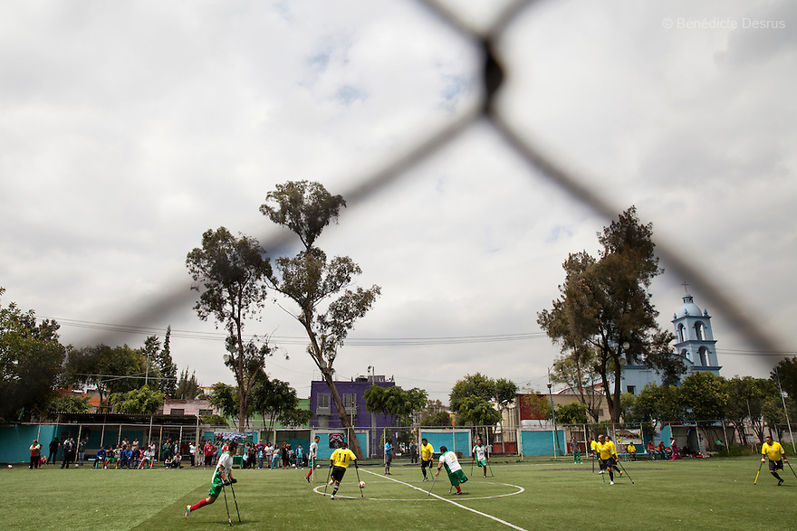 """Players from Guerreros Aztecas during a soccer game with Los Dragones (""""the Dragons"""") in Mexico City, Mexico on July 5, 2014. Guerreros Aztecas (""""Aztec Warriors"""") is Mexico City's first amputee football team. Founded in July 2013 by five volunteers, they now have 23 players, seven of them have made the national team's shortlist to represent Mexico at this year's Amputee Soccer World Cup in Sinaloathis December.The team trains twice a week for weekend games with other teams. No prostheses are used, so field players missing a lower extremity can only play using crutches. Those missing an upper extremity play as goalkeepers. The teams play six per side with unlimited substitutions. Each half lasts 25 minutes. The causes of the amputations range from accidents to medical interventions – none of which have stopped the Guerreros Aztecas from continuing to play. The players' age, backgrounds and professions cover the full sweep of Mexican society, and they are united by the will to keep their heads held high in a country where discrimination against the disabled remains widespread.(Photo byBénédicte Desrus)"""