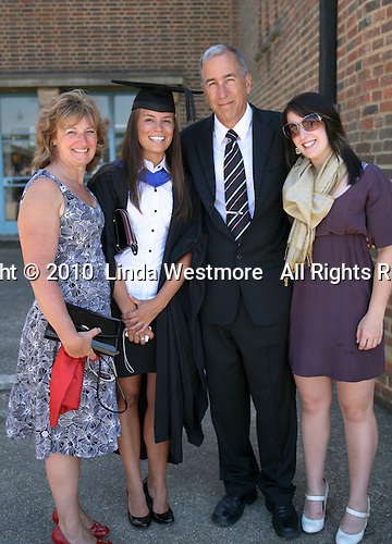Happy graduate with her family, University of Surrey.