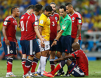 FORTALEZA - BRASIL -04-07-2014. Foto: Daniel Jayo / Archivolatino<br /> El juez Carlos Velazco cobra falta sobre Victor Ibarbo (#14) jugador de Colombia (COL) durante partido de los cuartos de final con Brasil (BRA) por la Copa Mundial de la FIFA Brasil 2014 jugado en el estadio Castelao de Fortaleza./ Carlos Velazco referee takes a foul on Victor Ibarbo (#14) player of Colombia (COL) during the match of the Quarter Finals with Brazil (BRA) for the 2014 FIFA World Cup Brazil played at Castelao stadium in Fortaleza. Photo:  Daniel Jayo / Archivo Latino<br /> VizzorImage PROVIDES THE ACCESS TO THIS PHOTOGRAPH ONLY AS A PRESS AND EDITORIAL SERVICE IN COLOMBIA AND NOT IS THE OWNER OF COPYRIGHT; ANOTHER USE IS REPONSABILITY OF THE END USER. NO SALES, NO MERCHANDASING. ALL COPYRIGHT IS ARCHIVOLATINO