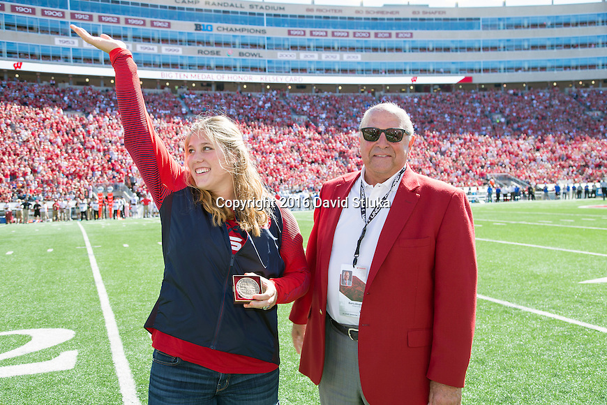 Wisconsin Badgers Kelsey Card waves to the crowd after receiving the Big Ten Medal of Honor from Athletic Director Barry Alvarez during an NCAA college football game against the Georgia State Panthers Saturday, September 17, 2016, in Madison, Wis. The Badgers won 23-17. (Photo by David Stluka)