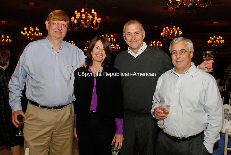 Plantsville, CT-15 November111512MK42 (from left) Jim McCloskey, Eileen Brewer-Akin, Bob Gigliotti and Anthony Mascolo gathered at the Connecticut High School Association Hall of Fame induction ceremony at the Aqua Turf in Southington recently. Michael Kabelka /Republican-American