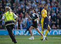 A young Manchester City fan invades the pitch and evades capture<br /> <br /> Photographer David Horton/CameraSport<br /> <br /> The Premier League - Brighton and Hove Albion v Manchester City - Sunday 12th May 2019 - The Amex Stadium - Brighton<br /> <br /> World Copyright © 2019 CameraSport. All rights reserved. 43 Linden Ave. Countesthorpe. Leicester. England. LE8 5PG - Tel: +44 (0) 116 277 4147 - admin@camerasport.com - www.camerasport.com