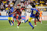 Clint Dempsey (10) and Gabriel Achilier (18)  of Ecuador. The men's national team of the United States (USA) Ecuador (ECU) during an international friendly at Red Bull Arena in Harrison, NJ, on October 11, 2011.