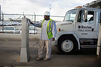 Jerome Whitaker uses a key fob to start fueling a Boston Public Works Department vehicle before going out to repair potholes in Boston, Massachusetts, USA, on April 12, 2012.  Using the key fob system, the Public Works Department monitors fuel usage per truck, which allows them to track vehicle maintenance.