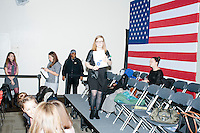 Emma Tyler, a Clinton campaign organizer for the Manchester area, walks through the audience before Democratic presidential candidate and former First Lady and Secretary of State Hillary Rodham Clinton speaks at the Women's Economic Opportunity Summit at Southern New Hampshire University in Hooksett, New Hampshire.