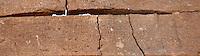 Latin carved inscription above the main entrance honoring Aurelius Aclepiades, Qsar Bshir, Mobene fortress, best preserved Roman fort in the world, Castra Praetoria, built 293 - 305, el-Qatrana, Jordan desert, Jordan. Picture by Manuel Cohen