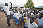 A teacher addresses students in a primary school at Odoubu in the Rhino Refugee Camp in northern Uganda. As of April 2017, the camp held almost 87,000 refugees from South Sudan, and more people were arriving daily. About 1.8 million people have fled South Sudan since civil war broke out there at the end of 2013. About 900,000 have sought refuge in Uganda.