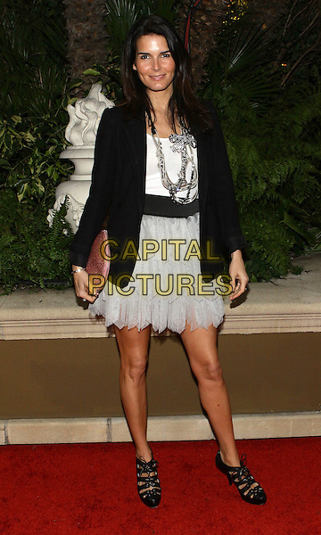 ANGIE HARMON.QVC  Celebrates Red Carpet Style At The Four Seasons Hotel  held at the Four Seasons, Beverly Hills, California, USA..March 5th, 2010.full length black jacket white dress clutch bag pink.CAP/ADM/TC.©T. Conrad/AdMedia/Capital Pictures.