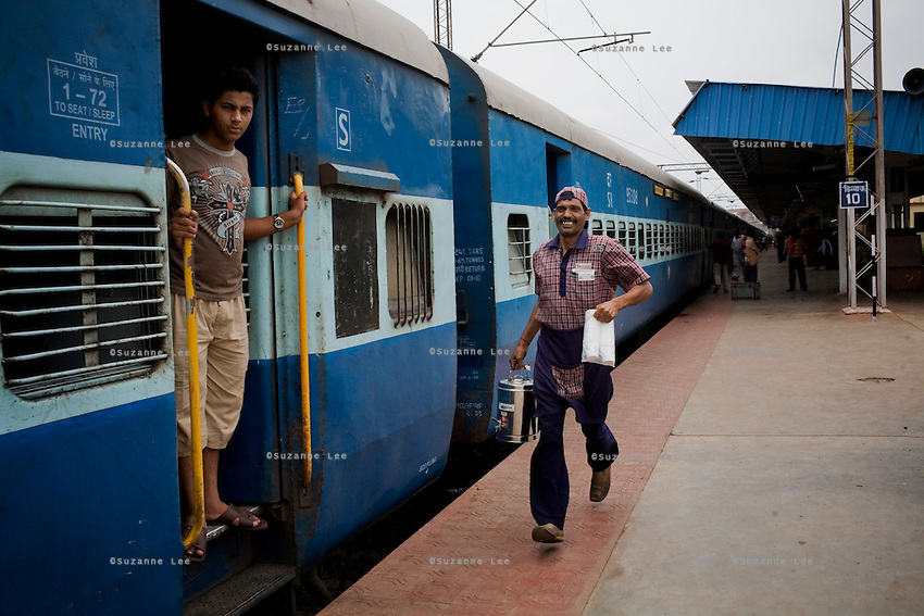 Ram Kumar, a chai wallah on board the Himsagar Express, runs to catch the train as it leaves Chandrapur Stn., Maharashtra on 8th July 2009.. .6318 / Himsagar Express, India's longest single train journey, spanning 3720 kms, going from the mountains (Hima) to the seas (Sagar), from Jammu and Kashmir state of the Indian Himalayas to Kanyakumari, which is the southern most tip of India...Photo by Suzanne Lee / for The National