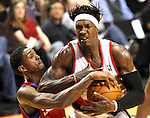 12/26/11--Trail Blazers forward Gerald Wallace grimaces while being fouled by 76ers' Louis Williams in the fourth quarter..Photo by Jaime Valdez. .........................................