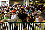 The crowd seeks shelter from the rain on Oaks Day, the day before the Kentucky Derby.