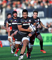 Hendon, England. Billy Vunipola of Saracens in action during the European Rugby Champions Cup match between Saracens and Munster at Allianz Park stadium on January 17, 2015 in Hendon, England.